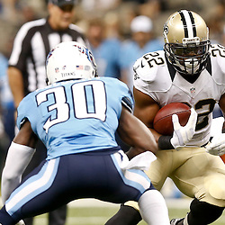 Aug 15, 2014; New Orleans, LA, USA; New Orleans Saints running back Mark Ingram (22) runs against Tennessee Titans cornerback Jason McCourty (30) during first quarter of a preseason game at Mercedes-Benz Superdome. Mandatory Credit: Derick E. Hingle-USA TODAY Sports