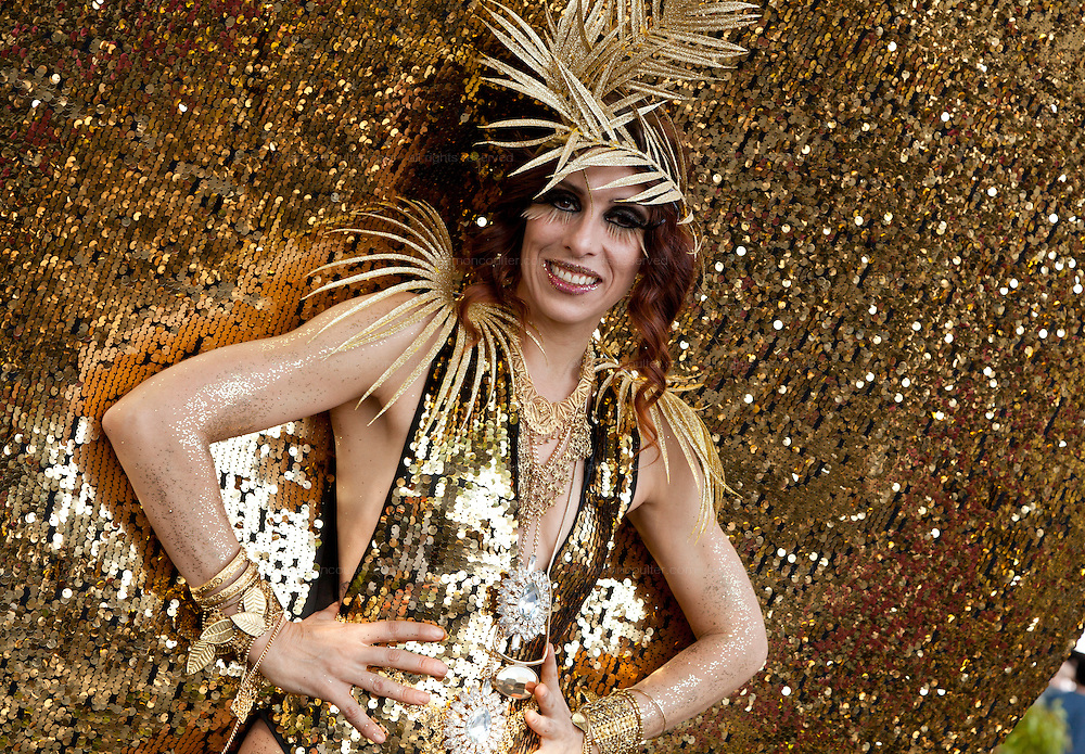 """Dutch performance artist, Merante Tamar van Amersfoort, who performs under the name, """"Merante in Wonderland"""" wearing a gold costume called the Sun Goddess for Diversity at Tokyo Rainbow Pride festival, Yoyogi Park, Tokyo, Japan. Sunday April 27th 2014 This was the third year this annual gay-pride event has been held in Japan capital.with food, fashion and health care stalls and musical performances set up in Yoyogi Park event square and a colourful parade around Shibuya at 1pm."""