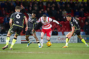 Doncaster Rovers Forward Liam Mandeville (14) battles with Bristol Rovers Forward Ellis Harrison during the EFL Sky Bet League 1 match between Doncaster Rovers and Bristol Rovers at the Keepmoat Stadium, Doncaster, England on 27 January 2018. Photo by Craig Zadoroznyj.