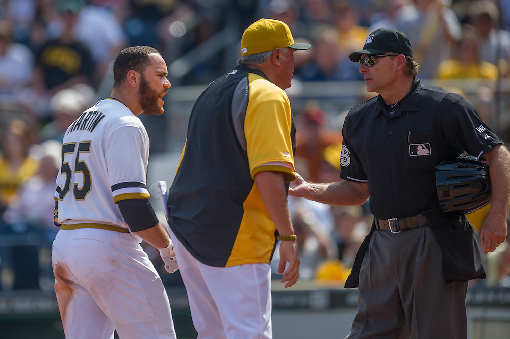 PITTSBURGH, PA - JUNE 08: Russell Martin #55 and Clint Hurdle #13 of the Pittsburgh Pirates exchange emotions with home plate Ed Hickox during the game against the Milwaukee Brewers at PNC Park on June 8, 2014 in Pittsburgh, Pennsylvania. (Photo by Rob Tringali) *** Local Caption *** Russell Martin;Clint Hurdle;Ed Hickox