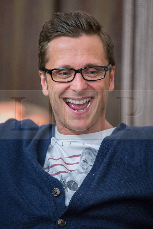 © Licensed to London News Pictures . 14/04/2014 . Phones 4U Arena , Manchester , UK . Ritchie Neville from Five . Photocall for former boyband stars as part of a reunion tour launch . Photo credit : Joel Goodman/LNP