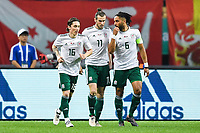 Gareth Bale, center, of Wales national football team celebrates with his teammates after scoring against Chinese national men's football team in the semi-final match during the 2018 Gree China Cup International Football Championship in Nanning city, south China's Guangxi Zhuang Autonomous Region, 22 March 2018.