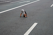 child playing in the street