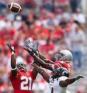 MORNING JOURNAL/DAVID RICHARD.Ohio State's  Anderson Russell, left, intercepts a pass intended for Earnest Jackson of Cincinnati in the fourth quarter. Also defending for the Buckeyes is Malcolm Jenkins.