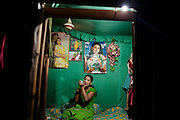 Asia, Bangladesh October 2012: .Maya was sold when she was 10 years old, in Daulatdia. A family friend brought her in this strange village where the women were having bath in the river, half naked in front of everyone..The maîtresse drug her rice  to make her sleep for few days. Her first time as a sex worker she was raped buy 2 younge boy. Her story is similar to almost every girls working in Daulatdia. .There is a brothel in Bangladesh that services 3,000 men a day. Sixteen hundred women live and work there.  Daulatdia, the biggest brothel in Bangladesh October 2012.  ©GIULIO DI STURCO..