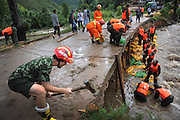 LANSHAN, CHINA - (CHINA OUT)<br /> <br /> Rescuers repair a road destroyed by floods  in Lanshan County, Hunan Province of China. Floods and mudslides triggered by typhoon Utor have killed 9 people in Hunan province.<br /> ©Exclusivepix