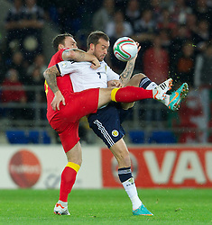 12.10.2012, Cardiff City Stadium, Cardiff, WAL, FIFA WM Qualifikation, Wales vs Schottland, im Bild Wales' Darcy Blake in action against Scotland's Steven Fletcher during FIFA World Cup Qualifier Match between Wales and Scotland at the Cardiff City Stadium, Cardiff, Wales on 2012/10/12. EXPA Pictures © 2012, PhotoCredit: EXPA/ Propagandaphoto/ David Rawcliffe..***** ATTENTION - OUT OF ENG, GBR, UK *****