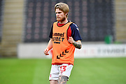 Middlesbrough defender Hayden Coulson (33)  warms up before the EFL Sky Bet Championship match between Hull City and Middlesbrough at the KCOM Stadium, Kingston upon Hull, England on 2 July 2020.