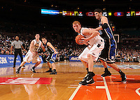 Southern Illinois guard Bryan Mullins #10 and Duke guard Greg Paulus #3 was as Duke center Brian Zoubek #55 guards Southern Illinois forward Carlton Fay #45. Duke beat Southern Illinois 83-58 to advance to the Championship of the 2008 2K Sports Classic at Madison Square Garden in New York.