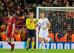 LIVERPOOL, ENGLAND - Tuesday, April 24, 2018: AS Roma's Edin Džeko carries the ball back to the centre circle after scoring his side's first goal during the UEFA Champions League Semi-Final 1st Leg match between Liverpool FC and AS Roma at Anfield. (Pic by David Rawcliffe/Propaganda)