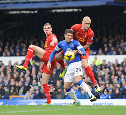 Everton's Ross Barkley challenges for the ball with Liverpool's Martin Skrtel - Photo mandatory by-line: Dougie Allward/JMP - Tel: Mobile: 07966 386802 23/11/2013 - SPORT - Football - Liverpool - Merseyside derby - Goodison Park - Everton v Liverpool - Barclays Premier League