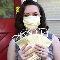 Liz Von Villas, a volunteer member of a group called Covid Mask Makers Orlando, is donating her time to create face masks due to the Coronavirus (COVID-19) threat on Tuesday, March 24, 2020 in Orlando, Florida.  The masks, once prepared will be washed, sanitized and donated to medical professionals across the country who are running out of critical protective equipment supplies. (Alex Menendez via AP)