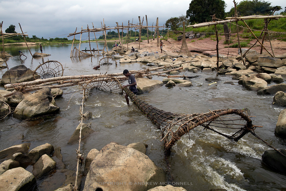 During the dry season the water levels drops to almost nothing and the fishing is poor, pictured at Wagenia Falls, DR  Congo. Fishermen use this time to build new wooden frames before the rains begin and the rapids rise again.