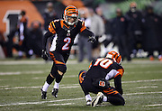 Cincinnati Bengals punter Kevin Huber (10) holds while Cincinnati Bengals kicker Mike Nugent (2) kicks a first quarter field goal that cuts the Cleveland Browns lead to 7-3 during the NFL week 10 regular season football game against the Cleveland Browns on Thursday, Nov. 6, 2014 in Cincinnati. The Browns won the game 24-3. ©Paul Anthony Spinelli