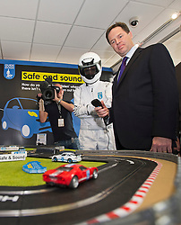 © London News Pictures. 24/09/2012. Brighton, UK.  Liberal Democrat Leader and Deputy Prime Minister, Nick Clegg playing with a Scalextric track on the Guide Dogs stand, while on a walk around on  day 3 of the Liberal Democrat Conference on September 24, 2012. Photo credit : Ben Cawthra/LNP.