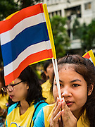 05 DECEMBER 2015 - BANGKOK, THAILAND:  A woman prays for the King in the plaza at Siriraj Hospital on the 88th birthday of Bhumibol Adulyadej, the King of Thailand. Hundreds of people crowded into the plaza hoping to catch a glimpse of the revered Monarch. The King has lived at Siriraj Hospital off and on for more than four years.    PHOTO BY JACK KURTZ