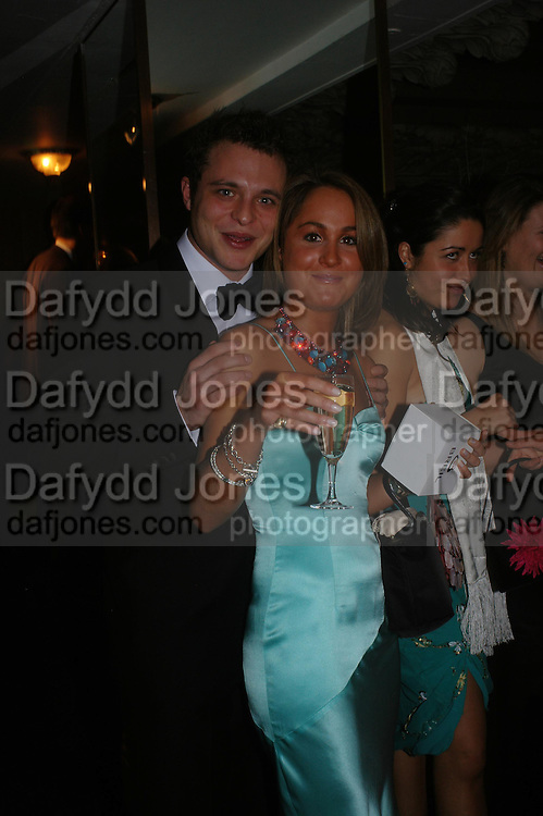 Daniel Clay and  Holly Millwood. White Knights Ball, Grosvenor House Hotel 7 January 2005. ONE TIME USE ONLY - DO NOT ARCHIVE  © Copyright Photograph by Dafydd Jones 66 Stockwell Park Rd. London SW9 0DA Tel 020 7733 0108 www.dafjones.com