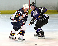 16 Jan 2010: Guildford, England. Lukas Smital of Guildford Flames (32) evades Luke Boothroyd (4) of Manchester Phoenix during the English Premier League match between Guildford Flames  Manchester Phoenix at Guildford (photo by Andrew Tobin/Slik Images)