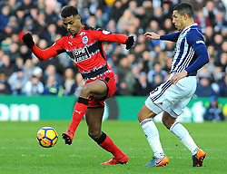 Steve Mounie of Huddersfield Town battles with Jake Livermore of West Bromwich Albion-Mandatory by-line: Nizaam Jones/JMP - 24/02/2018 - FOOTBALL - The Hawthorns - West Bromwich, England - West Bromwich Albion v Huddersfield Town- Premier League