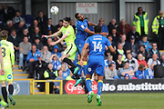AFC Wimbledon striker Tyrone Barnett (23) and Peterborough United defender Andrew Hughes (3) during the EFL Sky Bet League 1 match between AFC Wimbledon and Peterborough United at the Cherry Red Records Stadium, Kingston, England on 17 April 2017. Photo by Stuart Butcher.