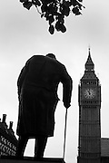 Ex-British statesman Winsoton Churchill's statue stands beneath Big Ben at 11.00am on Armistice day