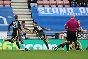 Wigan Athletic midfielder Nathan Byrne (10) shoots and goes close during the EFL Sky Bet Championship match between Wigan Athletic and Brighton and Hove Albion at the DW Stadium, Wigan, England on 22 October 2016.
