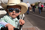 David McBirnie, 1, watches his first Tucson Rodeo Parade, the longest non-motorized parade in the nation. This 89-year-old event occurs each February in conjunction with La Fiesta de los Vaqueros, the Tucson Rodeo.  The event draws over 150,000 spectators in southern Tucson.