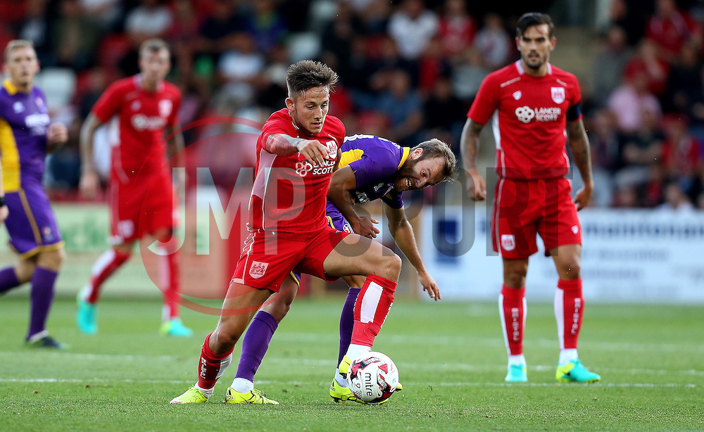 Josh Brownhill of Bristol City goes past James Dayton of Cheltenham Town - Mandatory by-line: Robbie Stephenson/JMP - 25/07/2016 - FOOTBALL - Abbey Business Stadium - Cheltenham, England - Cheltenham Town v Bristol City - Preseason Friendly