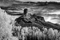 Chimney Rock & Courthouse Mountain above mountain meadow in autumn, Owl Creek Pass, CO