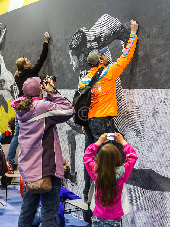 Boston Marathon: Expo, attendees signs mural on wall