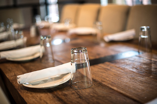 A simple table setting in a restaurant on a solid wooden table. & Rustic Restaurant Interior Design Table Setting | Have Camera Will ...