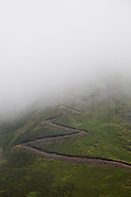 Path ascends into the mist of Cat Shoulder on Croft Head near Moffat, Southern Uplands, Scotland