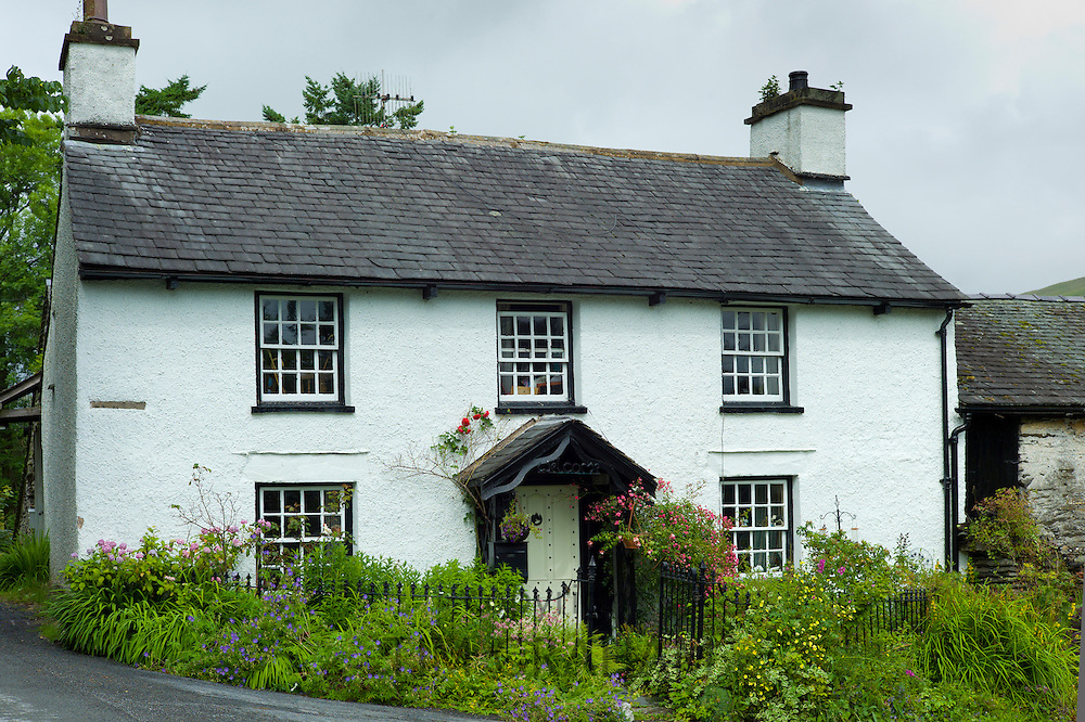 Quaint lakeland cottage and country lane at Troutbeck in the Lake District National Park, Cumbria, UK