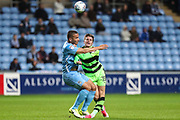 Forest Green Rovers Charlie Cooper(15) is tackled by Coventry City's Rod McDonald(5) during the EFL Sky Bet League 2 match between Coventry City and Forest Green Rovers at the Ricoh Arena, Coventry, England on 17 October 2017. Photo by Shane Healey.