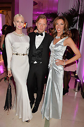 Left to right, AMANDA CRONIN, PETER ZAAR and HEATHER KERZNER at the QBF Spring Gala in aid of the Red Cross War Memorial Children's Hospital hosted by Heather Kerzner and Jeanette Calliva at Claridge's, Brook Street, London on 12th May 2015.