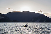 VERBANIA, ITALY - 18 APRIL 2017: A sailing boat is seen here at sunset in the Lake Maggiore in Verbania, Italy, on April 18th 2017.<br /> <br /> Emma Morano was an Italian supercentenarian who, prior to her death at the age of 117 years and 137 days, was the world's oldest living person whose age had been verified, and the last living person to have been verified as being born in the 1800s. She died on April 15th 2017.
