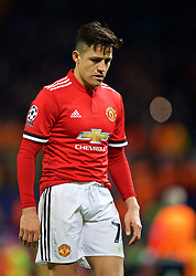 MANCHESTER, ENGLAND - Tuesday, March 13, 2018: Manchester United's Alexis Sánchez walks off the pitch dejected as his side crash out of Europe losing 1-2 to Sevilla during the UEFA Champions League Round of 16 2nd leg match between Manchester United FC and Sevilla FC at Old Trafford. (Pic by David Rawcliffe/Propaganda)