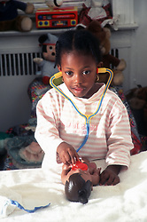 Small child playing doctors
