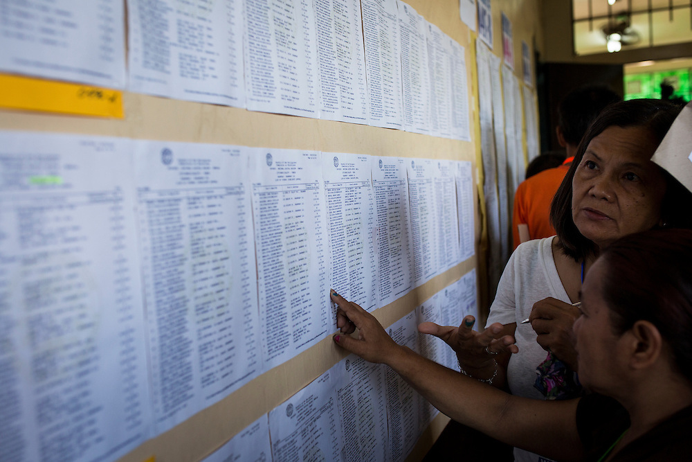 MANILA, PHILIPPINES - MAY 9: Residents line up to casts their votes in the presidential election at a polling station in Paaralang Timoteo Paez Elementary School in Tondo, Manila, Philippines on Monday morning of May 9, 2016. <br /> <br /> Photo by Richard A. de Guzman