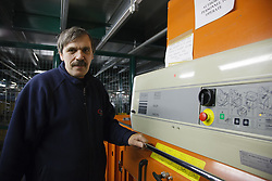 Man with a mild learning disability working as a factory operative, shown here operating machine to recycle plastic,helped into employment by the Ready 4 Work team, Nottinghamshire County Council