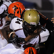 New Hanover High School's Ronnie Beatty tackles Ashley High School's Zach Judon Friday October 10, 2014 at Legion Stadium in Wilmington, N.C. (Jason A. Frizzelle)