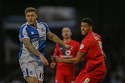 Bristol Rovers defender James Clarke  and York City forward Vadaine Oliver  during the Sky Bet League 2 match between Bristol Rovers and York City at the Memorial Stadium, Bristol, England on 12 December 2015. Photo by Simon Davies.