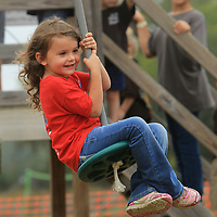 Gema Williams, 5, of Calhoun City, and a student at the Lewis Memorial Daycare in Calhoun City, smiles big as she rides the Zipline during her visit to the Pumpkin Patch at the Tupelo Buffalo Park and Zoo on Monday.