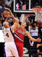 Nov. 21, 2012; Phoenix, AZ, USA; Phoenix Suns center Marcin Gortat (4) is blocked by the Portland Trail Blazers center Meyers Leonard (11) in the first half at US Airways Center. Mandatory Credit: Jennifer Stewart-US PRESSWIRE