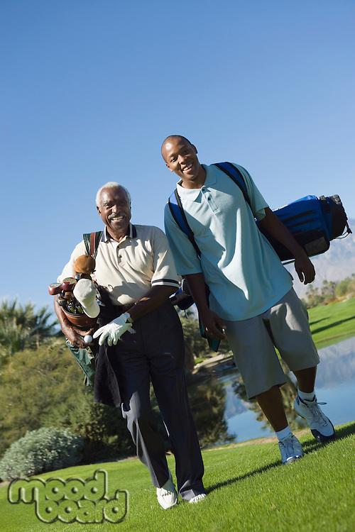Senior Golfer and Grandson