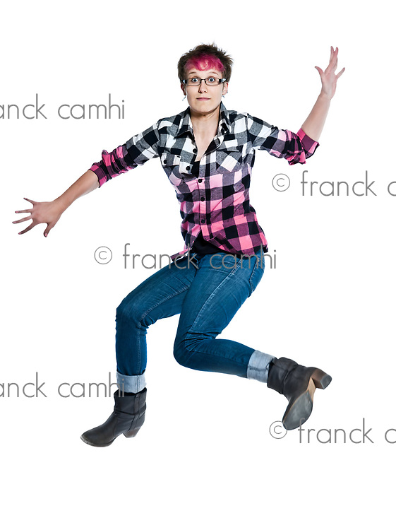 one caucasian  jumping trendy woman anxious full length in studio on white isolated background
