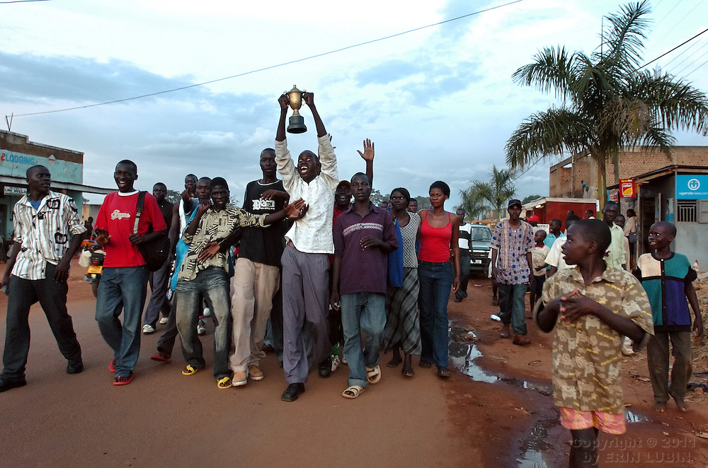 Young men celebrate a football victory as they walk down the main street in Gulu, north Uganda on October 6, 2006. Gulu is the main base for the UPDF, Uganda Peoples Defense Force, to fight the LRA, Lord's Resistance Army. Since the war began in 1987 over 2 million people have moved from their village homes to camps close to the town of Gulu where they can be protected from the LRA by the UPDF. Over the years the LRA are said to have abducted more than 30,000 children for use as soldiers in their army. The children were often tortured and girls were frequently used as sex slaves. Current peace talks between the Ugandan government and the LRA taking place in Juba, southern Sudan, have the north Ugandan community hoping for an end to the 20 year long war..Photo by Erin Lubin