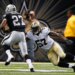 Aug 16, 2013; New Orleans, LA, USA; New Orleans Saints outside linebacker David Hawthorne (57) tackles Oakland Raiders running back Rashad Jennings (27) during the second quarter of a preseason game at the Mercedes-Benz Superdome. Mandatory Credit: Derick E. Hingle-USA TODAY Sports