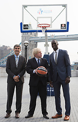 © Licensed to London News Pictures. 08/04/2013. London, England. Boris Johnson with Jordi Bertomeu, CEO and President of Euroleague Basketball (L) and Pops Mensah-Bonsu, GB Basketball Team. London Mayor Boris Johnson promotes the 2013 Turkish Airlines Euroleague Final Four to be played at The O2 from 10th - 12th May 2013, and to reveal the programme of free activities that will take place in conjunction with the event to get Londoners involved with basketball. Photo credit: Bettina Strenske/LNP