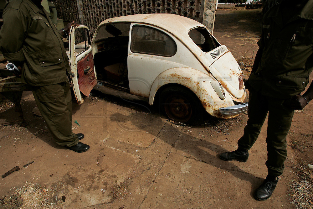 Soldiers show the Volkswagen Beetle that belonged to Amilcar Cabral, the Guinean independence hero, which the historic PAIGC leader was driving when he was assassinated January 20th 1973, now abandoned in a corner of the Amura fortress, presently used as an army barrack.